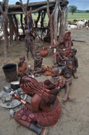 12 Himba people - butter making in the pot at the back.