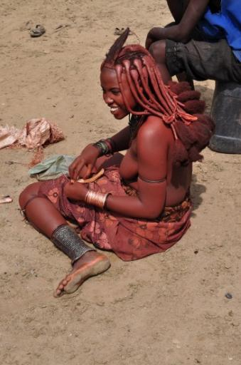 16 Himba lady - the red skin is from a crushed stone mixed with cow fat or vaseline.