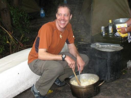 Mark on kitchen duty mashing potatoes
