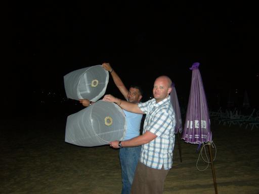 "Phuket - Dave and Rupesh lighting their ""kites"""
