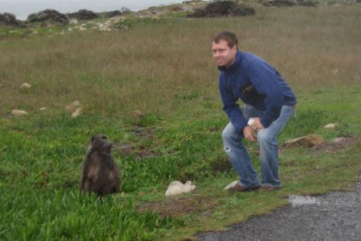 Travis squatting with his baboon buddy