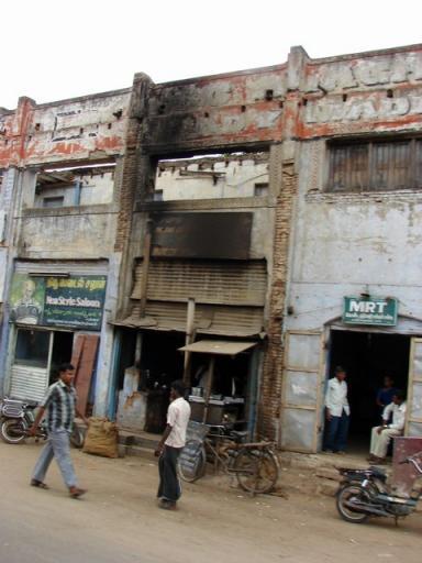 Kovai-I002- a burned out building